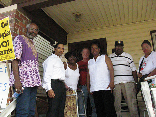 Workers World Party  leader Abayomi Azikiwe, Sen. Hansen Clarke, Rubie Curl-Pinkins, WWP member Alan Pollock, Debbie Williams, unidentified man and WWP member Sandra Hines on the porch of the  Curl-Pinkins home in Detroit, Aug. 22, 2008
