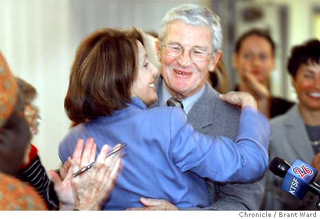 Nancy Pelosi Embracing Terence Hallinan