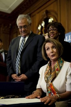 House Speaker Nancy Pelosi, D-CA, center, reaches out to Rep. Barney Frank, D-MA, after the passing of the most sweeping financial regulation in American History since The Great Depression.